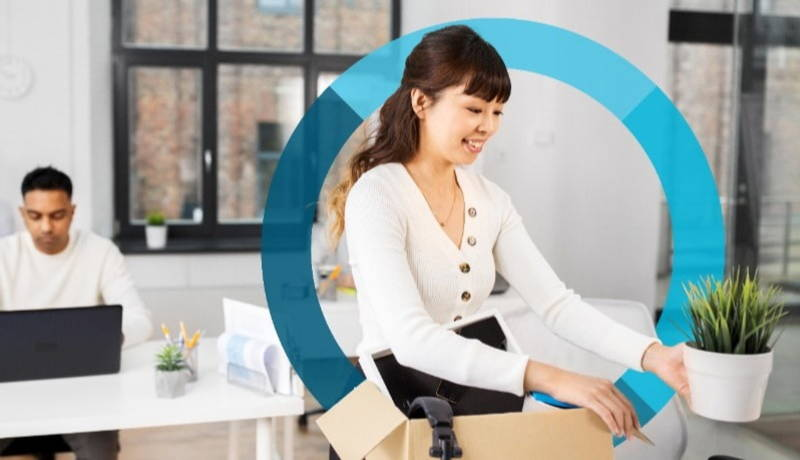 Woman smiling packing possesions